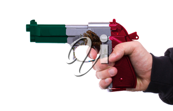 Pistol with Mexican flag pattern in hand, isolated on white background
