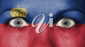 Close up of eyes. Painted face with flag of Liechtenstein