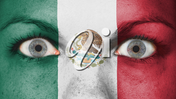 Close up of eyes. Painted face with flag of Mexico