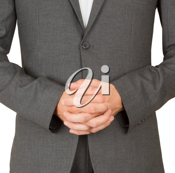 Business man in grey suit praying, isolated