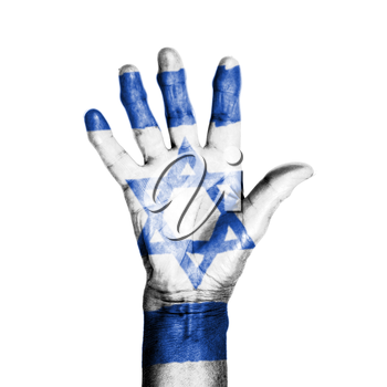 Hand of an old woman, wrapped with a pattern of the flag of Israel, isolated on white