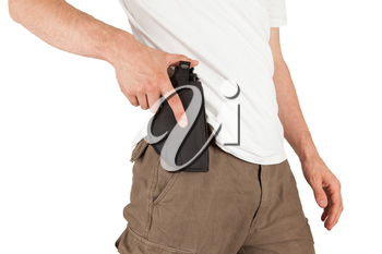 Close-up of a man with his hand on a gun, isolated on white