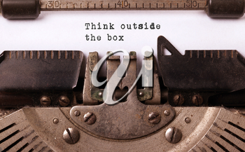 Vintage inscription made by old typewriter, think outside the box
