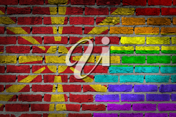 Dark brick wall texture - coutry flag and rainbow flag painted on wall - Macedonia