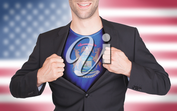 Businessman opening suit to reveal shirt with state flag (USA), Michigan