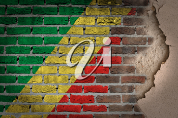 Dark brick wall texture with plaster - flag painted on wall - Congo