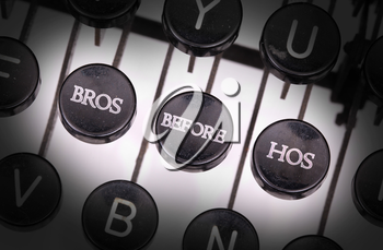 Typewriter with special buttons, bros before hos