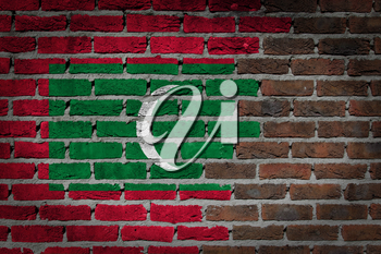 Very old dark red brick wall texture with flag - Maldives