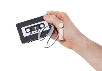 Vintage audio cassette tape, isolated on white background, 80's hits
