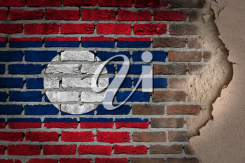 Dark brick wall texture with plaster - flag painted on wall - Laos