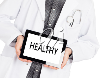 Doctor holding tablet, isolated on white - Healthy