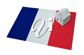 Small house on a flag - Living or migrating to France