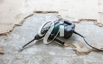 Construction concept - Jackhammer, removing chipboard from the floor - Selective focus