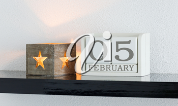 White block calendar present date 5 and month February on white wall background