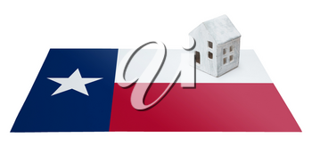 Small house on a flag - Living or migrating to Texas