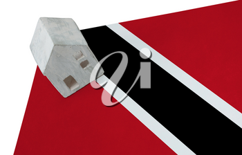Small house on a flag - Living or migrating to Trinidad and Tobago