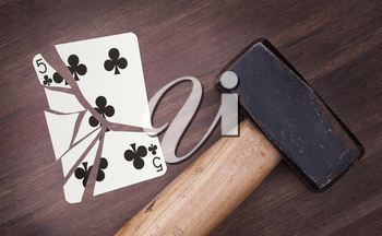 Hammer with a broken card, vintage look, five of clubs