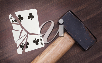 Hammer with a broken card, vintage look, four of clubs