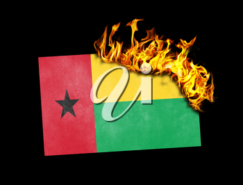 Flag burning - concept of war or crisis - Guinea Bissau