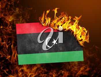 Flag burning - concept of war or crisis - Libya