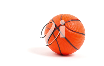 Small toy basketball ball isolated on white background