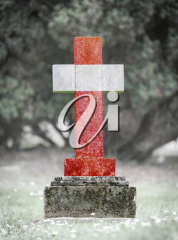 Old weathered gravestone in the cemetery - Austria
