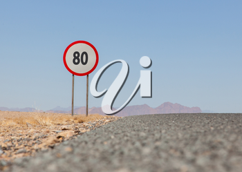 Speed limit sign at a desert road in Namibia, speed limit of 80 kph or mph