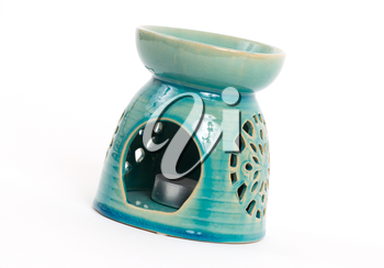 Candle in oil burner, isoalted on white