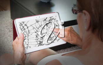 Senior lady with tablet, cracked screen, concept of insurance