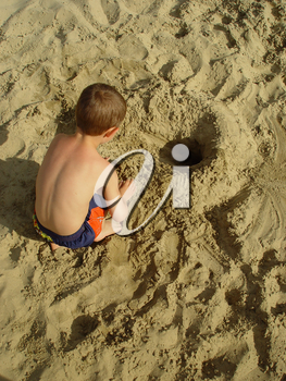 Stock Photography of a Child Playing in a Sandbox