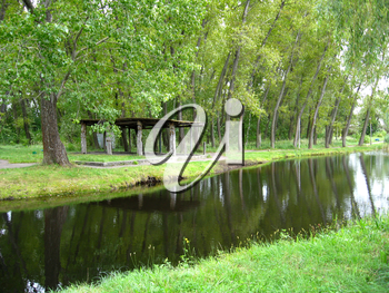 Beautiful city park with river and green trees