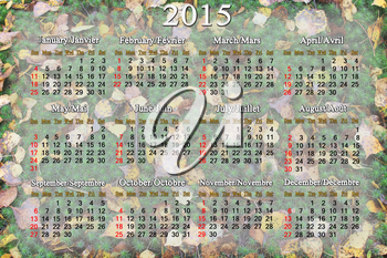 calendar for 2015 year on the background of green moss and autumn leaves