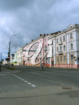 Street in Belarusian city of Gomel. City street with house with balconies. Road in modern city. roadway in city. Street of Belarusian city of Gomel. City life.