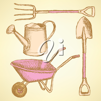 Garden fork, barrow, watering can and shovel, vintage background
