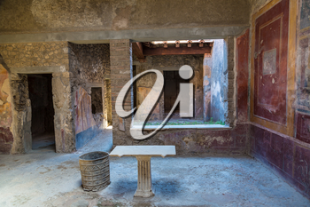 Living room in Pompeii city destroyed in 79BC by the eruption of volcano Vesuvius, Italy in a beautiful summer day