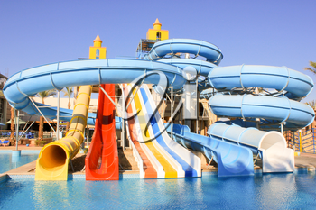 Water Slides at the Water Aquapark. Water Park for Kids at Sun Light.