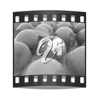 Apple earth and apples on a white background. The film strip