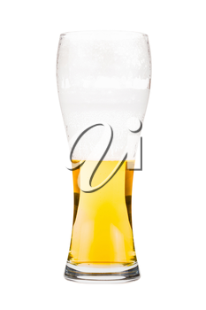 Tall beer glass almost full with lager beer, in the process of drinking. Someone already took a sip from the glass. Isolated on white