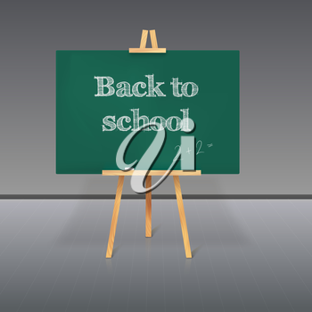Green school board with chalk on a tripod and an inscription Back to School
