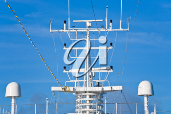 navigation antenna of cruise liner with blue sky on background