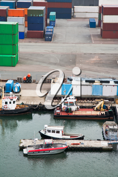 boats and freight containers in cargo port , Copenhagen