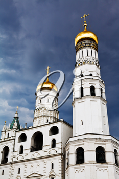 Ivan the Great Bell Tower and Assumption belfry in Moscow Kremlin over storm clouds