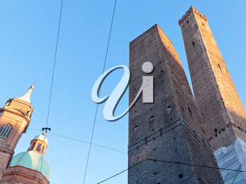 view of two tower - symbol of city under blue sky in Bologna, Italy