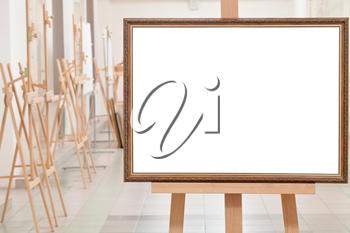 big picture frame with white cut out canvas on easel in gallery hall