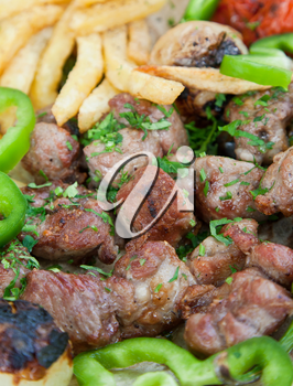 plate with arabic lamb kebab in Jordanian street restaurant
