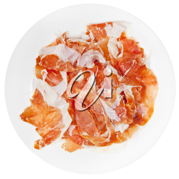 top view of sliced ham Prosciutto di Parma on plate isolated on white background