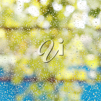 rain drops on window glass after summer shower background