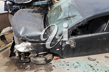 car broken during road accident on urban street