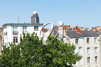 view of urban houses and Tour Bretagne (Brittany Tower) in Nantes, France