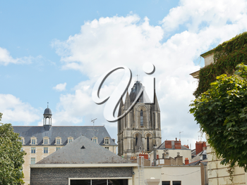 view of Saint-Aubin Tower over roof of urban houses in Angers city, France